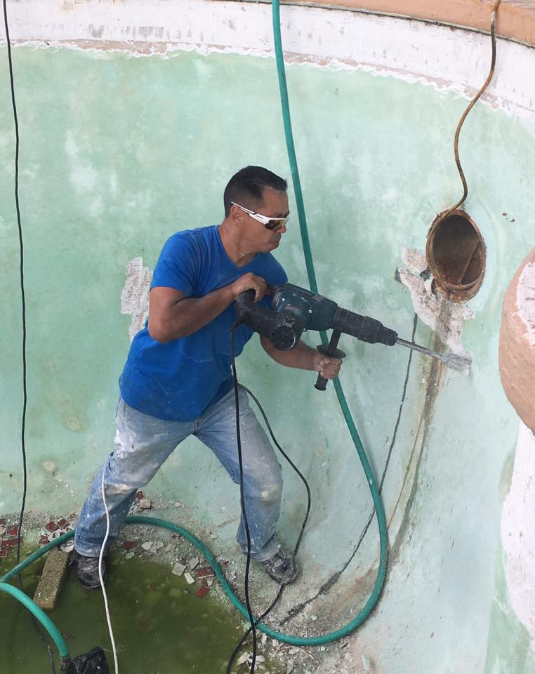 guy preparing pool to replaster